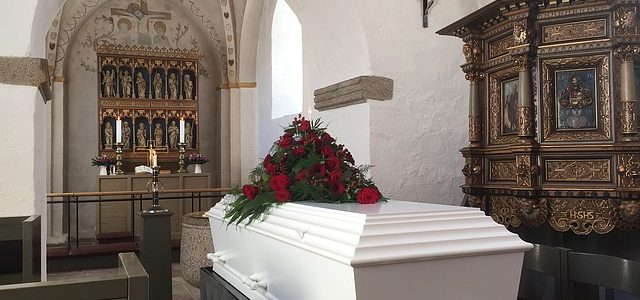 white coffin in church