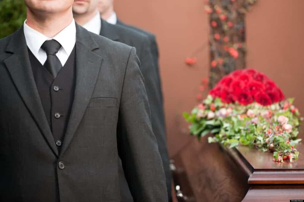 Picture of a pallbearer man at a funeral