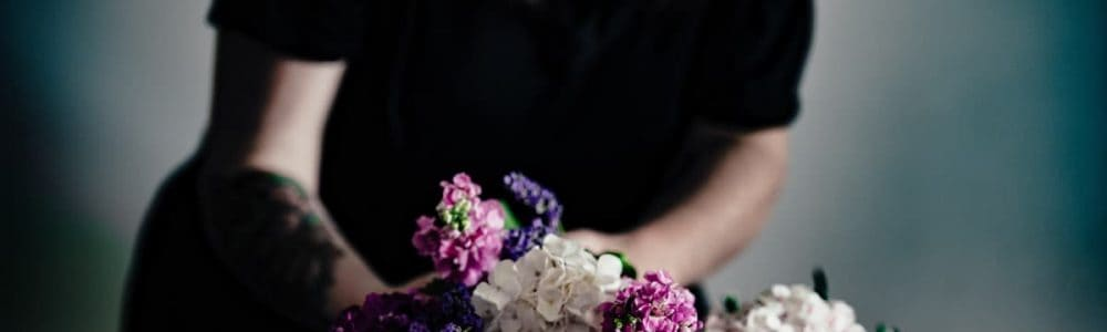 picture of a women giving flower at a funeral