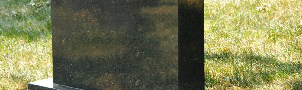 Burial polished granite headstone at grave